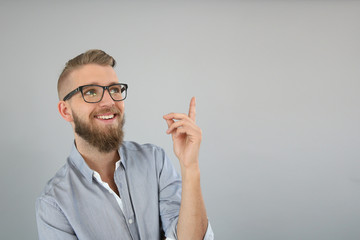 Trendy guy pointing at message, isolated