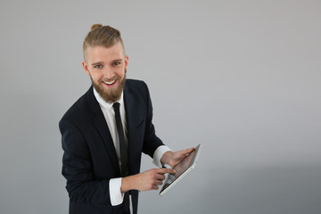 Young businessman showing digital tablet screen