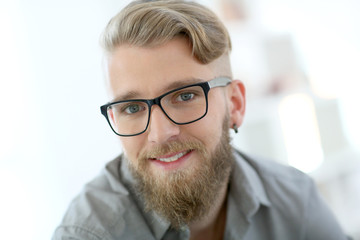Portrait of stylish young man with beard
