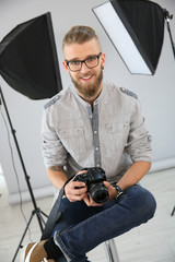 Portrait of young photographer working in studio