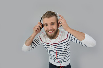 Cheerful trendy guy listening to music