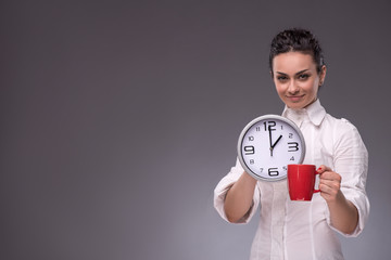Portrait of girl holding a big clock