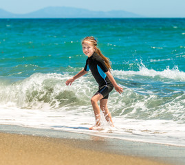 girl in a wetsuit on the beach