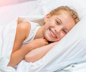 smiling little girl woke up