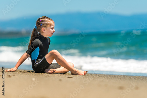 canvas print picture girl in a wetsuit on the beach