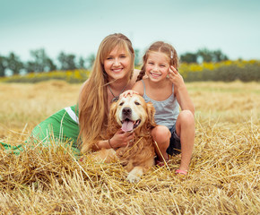 mother and daughter with a dog