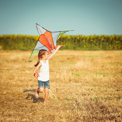 little girl with a kite