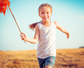 girl  holds windmill in hand