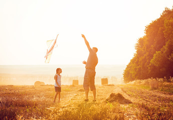 Dad with his little daughter let a kite