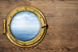 ship or boat porthole on wooden wall - 70990667