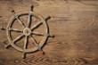 Steering wheel over wood background - 70990671