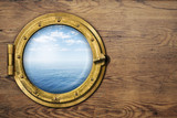 ship or boat porthole on wooden wall