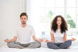 Couple meditating in the morning