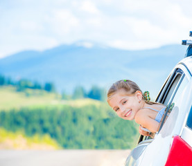 girl travel by car in the mountains