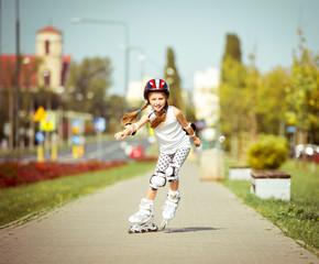 little girl rollerblading