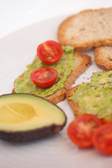 Healthy snack with avocado and tomatoes