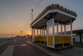 Beach front shelter and public benches on the English coast
