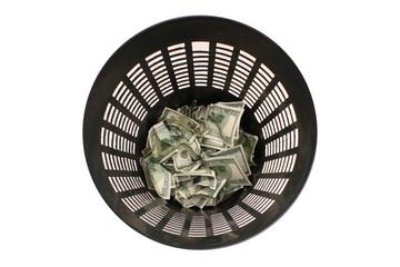 Money in basket. Dollars in the trash bin