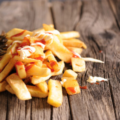 French Fries Covered in Tomato Ketchup and mayonaise