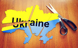 Cut map of Ukraine. Concept of disintegration of the country poster