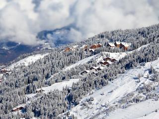 Snowy landscape with ski chalets, Meribel, the Alps, France