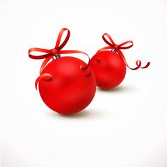 Zwei rote Weihnachtskugeln mit Schleife