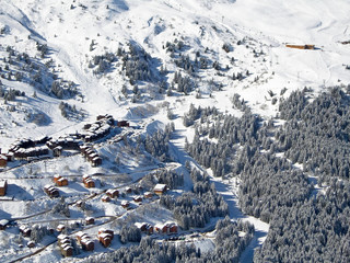 Snowy landscape with ski chalets, Meribel, the Alps, France