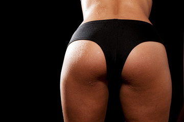 Young tanned woman with beautiful sporty buttocks