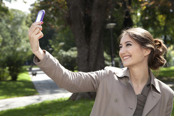 Woman photographing with mobile phone