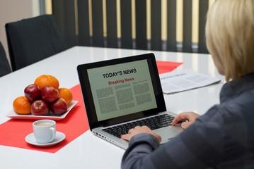 Woman reading breaking news