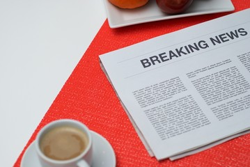 Breaking news on a white table at breakfast