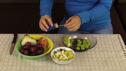 hand make snack grape and pears on wooden stick fruit vase table