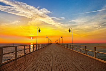 Sunrise at the pier in Orlowo, Poland.