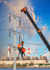 electrician worker working on high voltage electric pole with cr