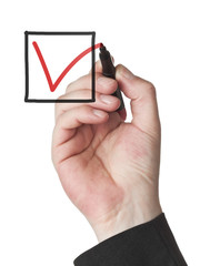 Male hand checking checkbox with red marker