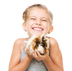 Little girl holding a guinea pig