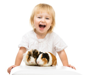 Little cute baby girl with guinea pigs
