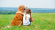 Little girl with golden retriever - 70998203
