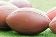 American football balls.