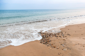 Atlantic ocean coast with sand and pebble