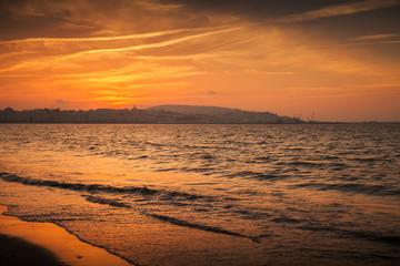 Atlantic ocean, red sunset in Tangier, Morocco