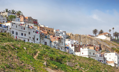 Street view with traditional colorful houses. Tangier, Morocco