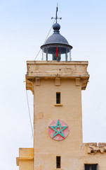 Yellow lighthouse tower in Cap Malabata, Tangier, Morocco