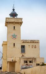 Yellow lighthouse tower. Cap Malabata, Tangier, Morocco
