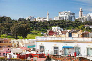 Ordinary living houses and mosques. Cityscape of Tangier, Morocc