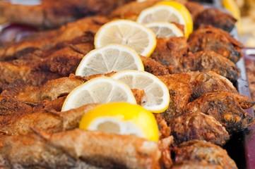 Fresh fried fish with lemon slice