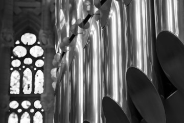 Closeup black and white photo of organ in Catholic Church