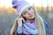 Pretty young woman wearing hat and scarf. Close up