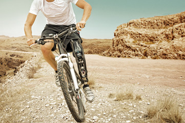 Handicapped mountain bike rider barren landscape