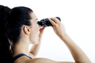 beautiful woman searching with binoculars